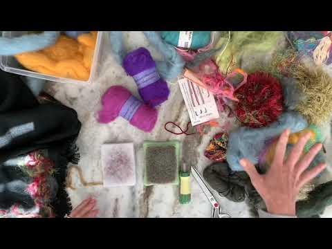 Needle felting fibers on a pre-made shawl